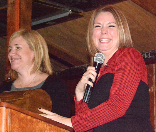 Debbie Blank | The Herald-Tribune<br /> Outgoing President Carrie Rupp (left) and executive director Anna Ibold share a chuckle at the podium.