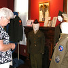Photos by Debbie Blank | The Herald-Tribune<br /> WE REMEMBER EXHIBIT: Joann Fledderman, Batesville, views the uniform of her late uncle, Joseph Dierckman. The public may visit the military exhibit during museum hours through Labor Day: Thursdays, 9 a.m.-3 p.m.; and Fridays-Saturdays, 9 a.m.-noon. The museum is located at 15 W. George St.