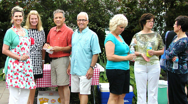 Debbie Blank | The Herald-Tribune<br /> Society members and guests, including (from left) Ginger Flannery, Mary Jon McCaig, Ed Burdett, Bill Flannery, Melissa Tucker, Donna Burdett and Pat Meer, gather in the garden.