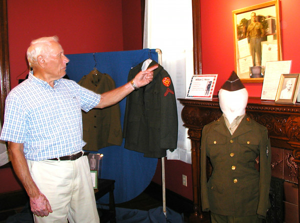 "Debbie Blank | The Herald-Tribune<br /> WORLD WAR II: Looking at the exhibit, Al Geis said, ""I remember when Aloysius Schulte got killed"" during the war."