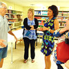 "Debbie Blank | The Herald-Tribune<br /> At the pantry, volunteer Tom Demalon (from left) told Batesville Area Chamber of Commerce President Carrie Rupp, office coordinator Patricia Hatcher and Vice President Bev Broughton, ""Most of the food we get comes from private donations, Gleaners"" Food Bank of Indiana and Thrive Market, Batesville."