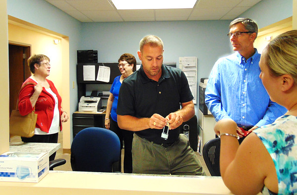 Debbie Blank | The Herald-Tribune Southeast Indiana Health Center manager Paul Tyrer (center) chats with BARC President Angela Byers (right). Three of the nine board members, Connie DeBurger (from left), Linda Tuttle and Dr. Steve Glaser, also were in the center's office.