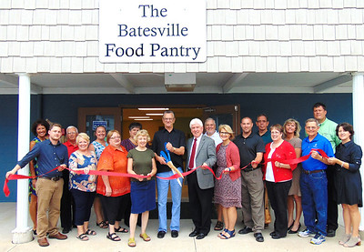 Debbie Blank | The Herald-Tribune The ribbon officially opening the Batesville Food Pantry housed within the Batesville Area Resource Center was cut by donor Ron Fledderman. Helping him are (front row from left) community development director Steven Harmeyer, Batesville Area Chamber of Commerce Vice President Bev Broughton, BARC board member Lisa Haessig, pantry co-coordinator Anne Baran, Mayor Mike Bettice, BARC Vice President Dr. Jere Schoettmer, Southeast Indiana Health Center manager Paul Tyrer, SEIHC board member Connie DeBurger, BARC board member Dennis Harmeyer and city administrative assistant Andrea Wade; (back row) BACC office coordinator Patricia Hatcher, BARC board member Bob Erne, BARC President Angela Byers, BARC past President and board member Sue Siefert, BARC board members Robert Jester and Ed Krause, economic development director Sarah Lamping and SEIHC board member Brad Mehlon. Donor Doug Bessler is not pictured.