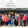 Debbie Blank | The Herald-Tribune<br /> The ribbon officially opening the Batesville Food Pantry housed within the Batesville Area Resource Center was cut by donor Ron Fledderman. Helping him are (front row from left) community development director Steven Harmeyer, Batesville Area Chamber of Commerce Vice President Bev Broughton, BARC board member Lisa Haessig, pantry co-coordinator Anne Baran, Mayor Mike Bettice, BARC Vice President Dr. Jere Schoettmer, Southeast Indiana Health Center manager Paul Tyrer, SEIHC board member Connie DeBurger, BARC board member Dennis Harmeyer and city administrative assistant Andrea Wade; (back row) BACC office coordinator Patricia Hatcher, BARC board member Bob Erne, BARC President Angela Byers, BARC past President and board member Sue Siefert, BARC board members Robert Jester and Ed Krause, economic development director Sarah Lamping and SEIHC board member Brad Mehlon. Donor Doug Bessler is not pictured.