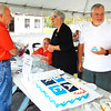 Debbie Blank | The Herald-Tribune<br /> Volunteers (from left) Jerry Bennett, Lisa Haessig and Sandi and Robert Jester man the door prizes and cake area.