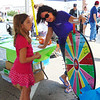 Diane Raver | The Herald-Tribune<br /> Lacey Gillman, 8, Batesville, spun the wheel in the Children's Health Care Kids Zone as registered nurse Jodi Meister watched.