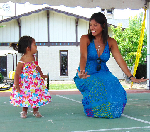 Diane Raver | The Herald-Tribune<br /> Laura Conejo and daughter Luna, 2, enjoyed salsa dancing on the stage.