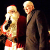 Diane Raver | The Herald-Tribune<br /> Santa talks to the crowd as Mayor Mike Bettice listens during the eighth Batesville Community Tree Lighting Dec. 7.