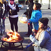 Diane Raver | The Herald-Tribune<br /> Persons stood by the fire to roast marshmallows and stay warm.
