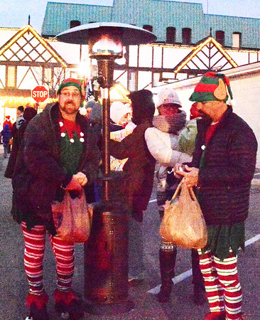 Diane Raver   The Herald-Tribune<br /> Even Santa's elves had to find a place to warm up.