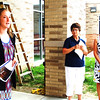 Debbie Blank | The Herald-Tribune<br /> Senior Ashley Daulton (from left) led RAA volunteers Leacarol Bennett and Regina Siefert and the rest of participants through the cafeteria to begin the tour at the new north entrance.