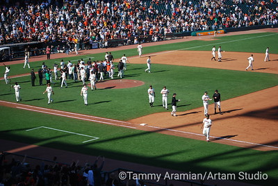 Giants disperse to toss balls and souvenirs into the crowd