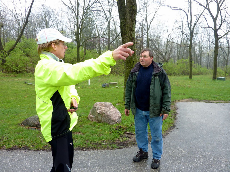 Robert tells the ranger what areas of the park we need to have rain-free on race day.