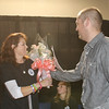 Michael Fishman, Development Associate at The Boys & Girls Clubs of Marin and Southern Sonoma Counties, hands Krista Gawronski flowers in gratitude at The Fabulous Women's event , Because I'm A Girl, held on Saturday October 12 , 2013 at the Boys & Girls Club.