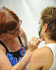 Bedford BBQ and Blues Fest<br /> NORA SUSKO puts the finishing touches on a face tattoo for CANDY ESQUIBEL