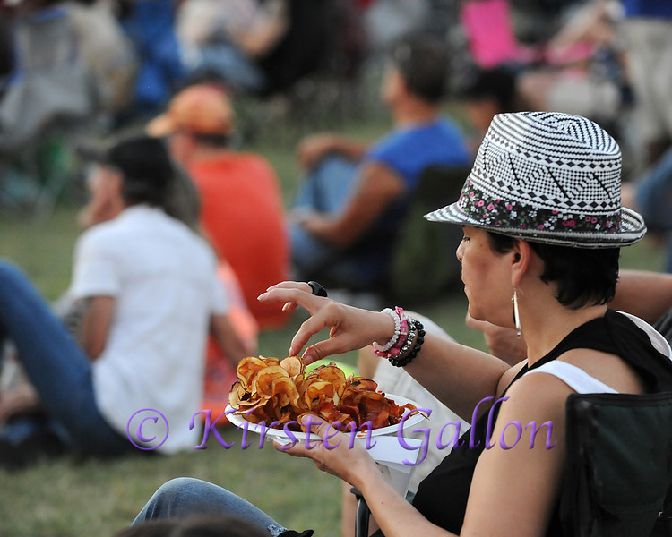 Bedford BBQ and Blues Fest<br /> DIANA OSBORNE enjoys a plate of homemade potato chips while listening to John Mayall.