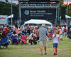 Bedford BBQ and Blues Fest<br /> The sun sets on another day of the blues as a father and daughter walk back to their seats to get ready for another performer.