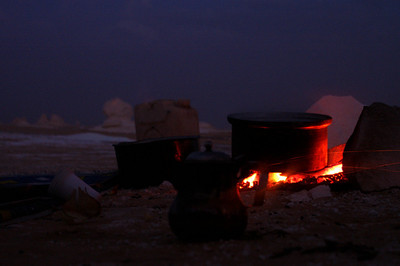 Camping in the white desert - dinner is cooking on the fire