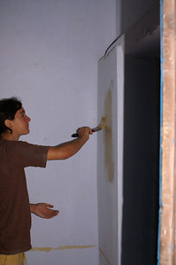 We finally got the first classroom all cleaned up (though not dry) so that we could paint it. Our supervisor claimed that the paint was especially designed for wet walls, but somehow we have our doubts about the longevity of our work
