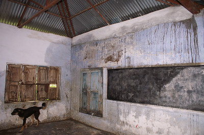 You can see in what desperate condition this class room is. The darker areas of the wall are the parts where the wall is humid enough that your hand gets wet by just touching the wall... Great conditions.