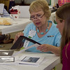Bobbie Hilmer received great feedback from photography judge Claudette Taylor Wednesday afternoon at the Benton Co. Fair.