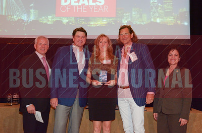 Cedar Hill mayor, Rob Frankeand Allison Thompson, Director of Economic Development for Cedar Hill present the Best Real Estate Deals award for Best Commercial Property to Dunhill Partners for their Dallas Design District.