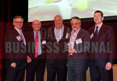 The team for the former Statler Hilton and Old Library Development Project celebrate their Best Rehab/Reuse Deal award