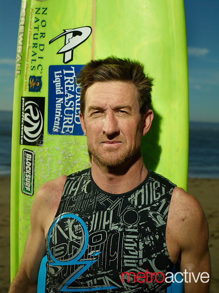 """Shane Desmond before his heat at the 2013 Mavericks Invitational surf competition in Half Moon Bay, California.  Photo by Peter Adams  <a href=""""http://www.peteradamsphoto.com"""">http://www.peteradamsphoto.com</a>)."""