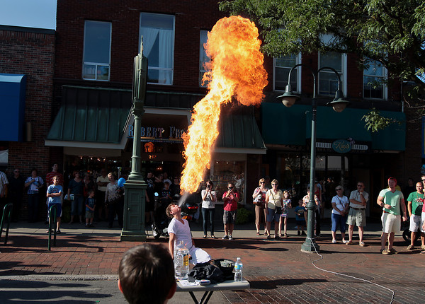 Record-Eagle/Keith King<br /> Mitchell Mosley, 14, of Traverse City, performs a fire-spitting routine Friday, July 20, 2012 as part of his act along Front Street during Friday Night Live.