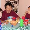 Julio's nephews enjoy their supper