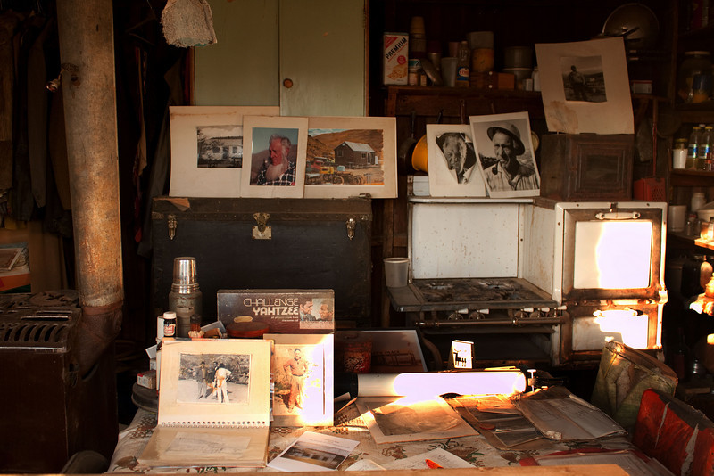 Shown here is the interior of Bickel's cabin showing photos and various memorabilia. Recently Friends of Bickel Camp re-installed Bickel's heating and cooking stoves. With Mark Aslin living at the camp thefts of such artifacts has been greatly reduced.