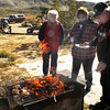 The fire dances for Tom Cody as Laura Ann Bickel and sister Colleen step to the warm grill. We all seem to be remembering something we never knew.