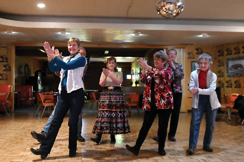Matthew Gaston | The Sheridan Press<br>Members of the Bighorn Country Dancers, from left, Teresa Gustafson, Goldie Steigleman, Melba Bennett, Cindy Purcella and Vanna Schwamb do a line dance at the Elks Lodge Thursday, Nov. 29, 2018.