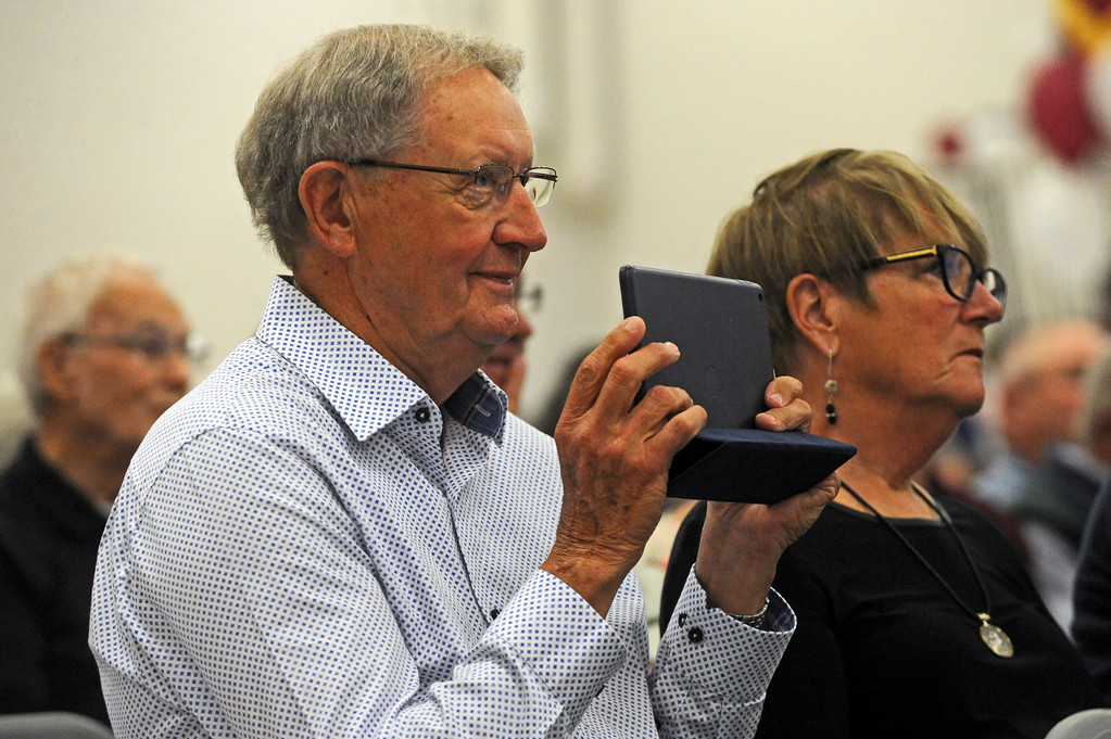 Ken Beckley films from his tablet during granddaughter Lydia Mayer's salutatorian address at the graduation ceremony on Sunday, May 28 at Big Horn High School. Mike Pruden | The Sheridan Press