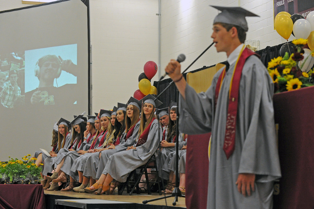 "The class of 2017 looks on as classmate Tanner Warder sings ""Remember Me"" by Christina Rossetti during the graduation ceremony on Sunday, May 28 at Big Horn High School. Mike Pruden 