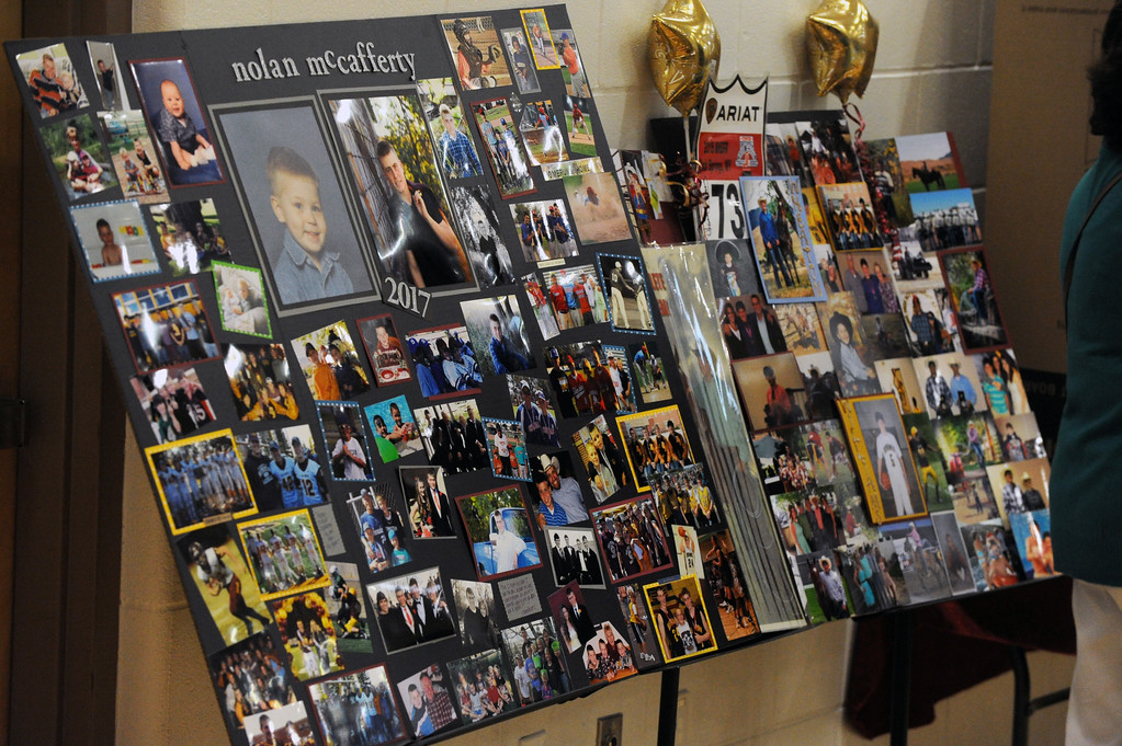 Photo boards line the back wall of the Big Horn High School gymnasium during the graduation ceremony on Sunday, May 28 at Big Horn High School. Mike Pruden | The Sheridan Press
