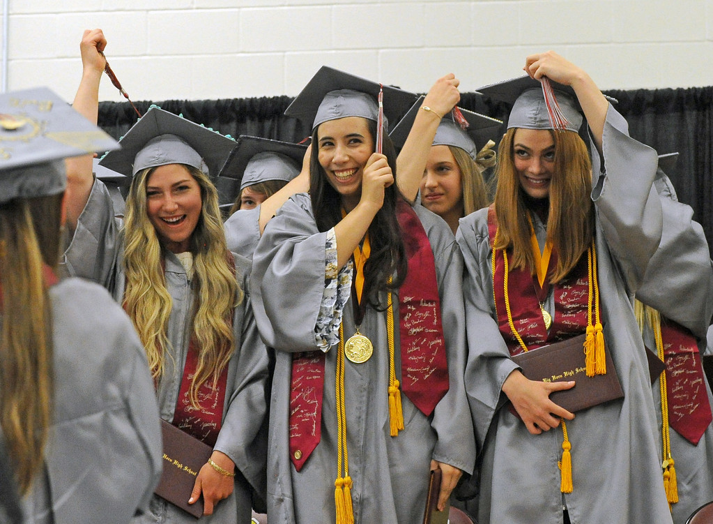 Big Horn graduates, from left, Emmy Ilgen, Kiara Paninos and Lydia Mayer, move their tassels at the end of the graduation ceremony on Sunday, May 28 at Big Horn High School. Mike Pruden | The Sheridan Press