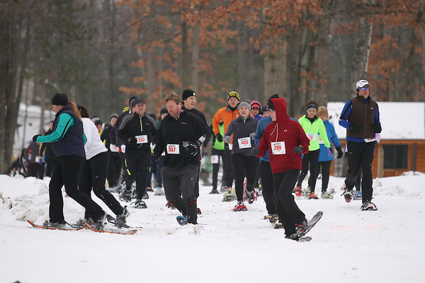 Record-Eagle/Keith King<br /> Participants make their way along the course Saturday, January 19, 2013 during the Bigfoot Snowshoe Race 5k/10k at Timber Ridge Resort.