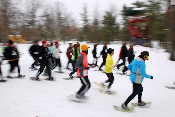 Record-Eagle/Keith King<br /> Participants take off from the starting line Saturday, January 19, 2013 during the Bigfoot Snowshoe Race 5k/10k at Timber Ridge Resort.