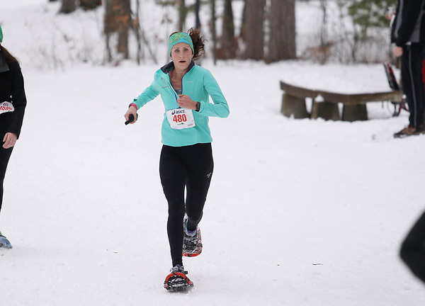 Record-Eagle/Keith King<br /> Erin O' Mara (480), of Linden, finishes first in the womens 10k Saturday, January 19, 2013 during the Bigfoot Snowshoe Race 5k/10k at Timber Ridge Resort.