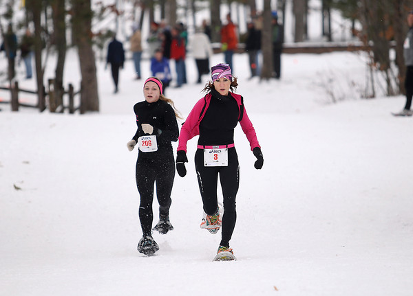 Record-Eagle/Keith King<br /> Nancy Agrillo (3), right, of Grand Rapids, finishes first and Kaitlin O' Mara, (206), second, in the womens 5k Saturday, January 19, 2013 during the Bigfoot Snowshoe Race 5k/10k at Timber Ridge Resort.