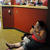 Sabrina Palumbo of  Pueblo found a quiet spot to put on her make-up on while waiting for Saturday's open casting call for The Biggest Loser 11 at the 1st Bank Center in Broomfield.<br /> July 17, 2010<br /> Staff photo/ David R. Jennings