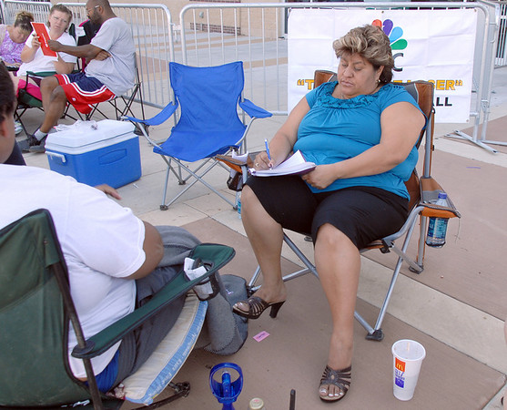 Lisa Urquizo, of Henderson, first in line since Friday night, fills out the casting form for Saturday's open casting call for The Biggest Loser 11 at Broomfield's 1st Bank Center.<br /> July 17, 2010<br /> Staff photo/ David R. Jennings