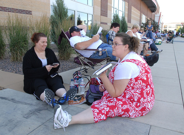 Stacy Wright, left, gives advise to her sister Jenny Schwertfeger while filling out the short form for Saturday's open casting call for The Biggest Loser 11 at Broomfield's 1st Bank Center.<br /> July 17, 2010<br /> Staff photo/ David R. Jennings