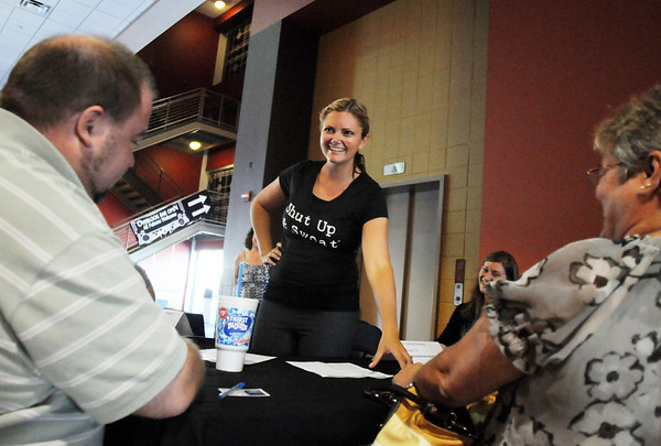 Casting Director Holland Striplin, center, talks with applicants during Saturday's open casting call for The Biggest Loser 11 at Broomfield's 1st Bank Center.<br /> July 17, 2010<br /> Staff photo/ David R. Jennings