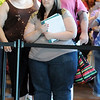 Aundrea Grajeda, of Denver, stands in line for the next four groups of  ten people to be interviewed for Saturday's open casting call for The Biggest Loser 11 at Broomfield's 1st Bank Center.<br /> July 17, 2010<br /> Staff photo/ David R. Jennings