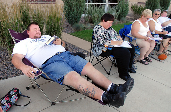 Josh Haigh, of Wheatridge, sits in a portable lounge chair while waitng for Saturday's open casting call for The Biggest Loser 11 at Broomfield's 1st Bank Center.<br /> July 17, 2010<br /> Staff photo/ David R. Jennings