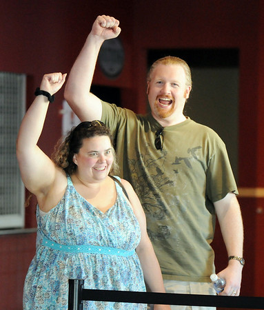 Denise and Christian Pruett of Castle Rock cheer as they find out they're next in line for Saturday's open casting call for The Biggest Loser 11 at Broomfield's 1st Bank Center.<br /> July 17, 2010<br /> Staff photo/ David R. Jennings