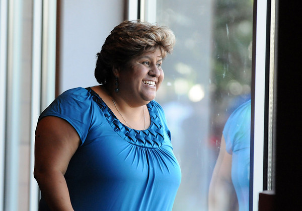Lisa Urquizo, of Henderson, first in line, smiles at friends a family outside during Saturday's open casting call for The Biggest Loser 11 at Broomfield's 1st Bank Center.<br /> July 17, 2010<br /> Staff photo/ David R. Jennings