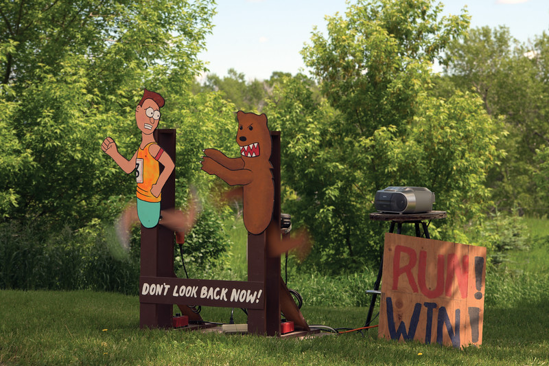 "Matthew Gaston | The Sheridan Press<br>A Dayton resident contructed a motivational sign and played ""Eye of the Tiger"" on a boom box to encourage runners on the final leg of the Bighorn Trail Run Saturday, June 15, 2019."